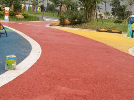 Colored abrasion resistant pavement coating